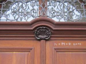 Wood carved scallop shell on one of the church buildings at Praha Zbraslav.