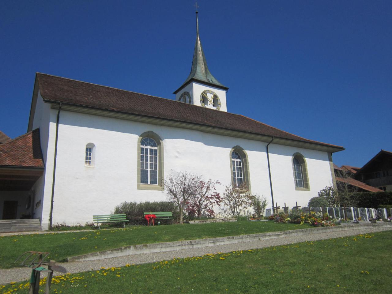 Pilgrim Nev tinkering with the piano keys at Rueggisberg church, on the SwissJakobsweg