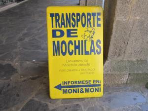 Transport-of-rucksacks-in-Portomarin