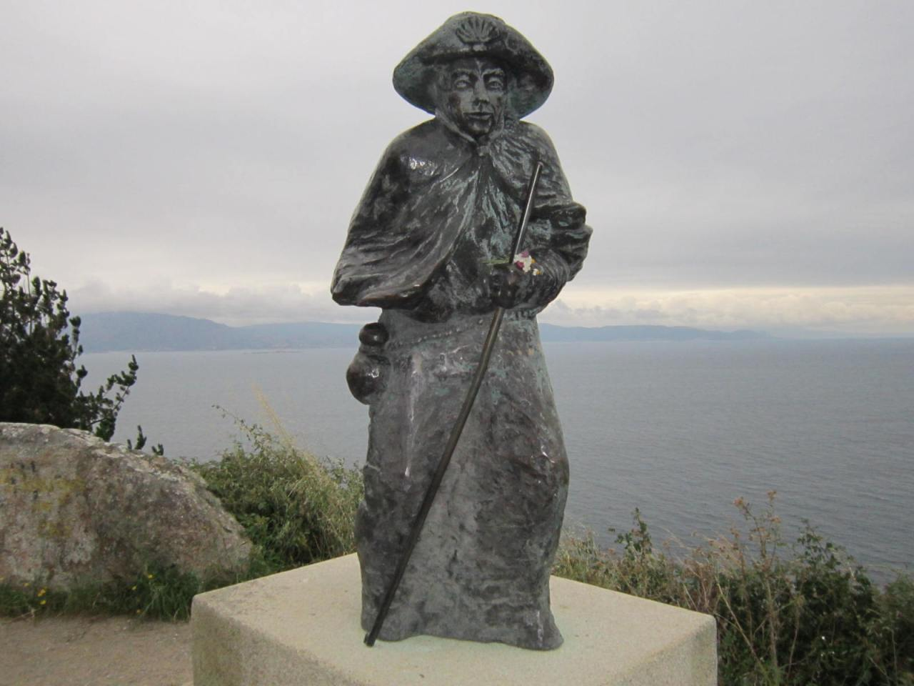 Statue of a wind-blown pilgrim at Cape Finisterre/Fisterra (Camino Finisterre/Fisterra)