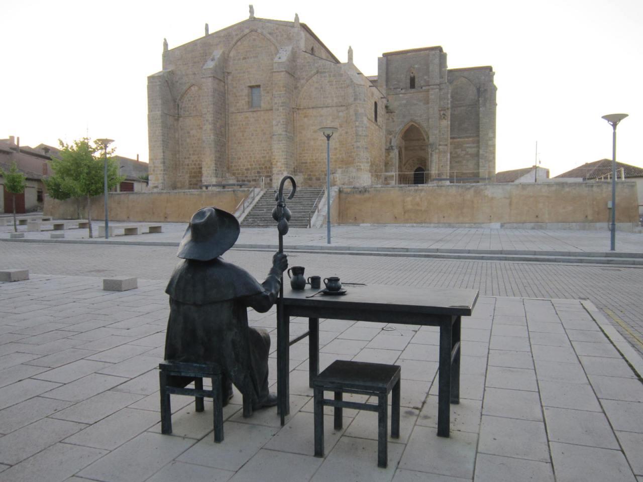 Pilgrim taking a breakfast break in the main square at Villalcazar de Sirga (between Fromista and Carrion de losCondes)