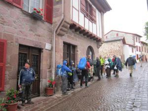 Pilgrims line up to enter Pilgrim office