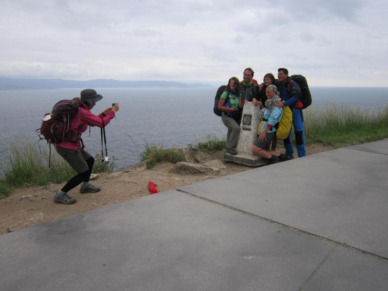 Pilgrims at point 0,00km (Cape Finisterre/Fisterra at the end of the world)